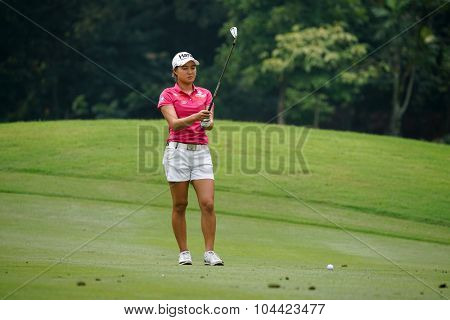 KUALA LUMPUR, MALAYSIA - OCTOBER 10, 2015: Australia's Minjee Lee tees off at the sixth hole of the KL Golf & Country Club on Round 3 day at the 2015 Sime Darby LPGA Malaysia golf tournament.