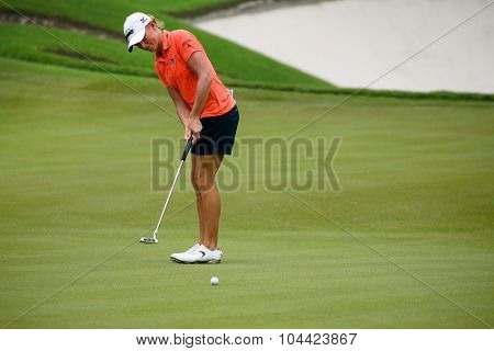 KUALA LUMPUR, MALAYSIA - OCTOBER 10, 2015: USA's Stacy Lewis putts on the green of the 18th hole of the KL Golf & Country Club during the 2015 Sime Darby LPGA Malaysia golf tournament.