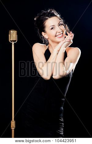 Smiling Woman Singer Behind Retro Microphone