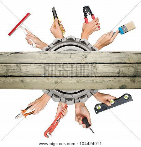 Peoples hands holding tools on white