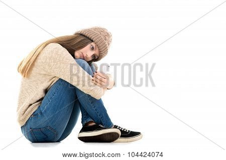 Teenage Girl Waiting For Call With Smartphone In Her Hands