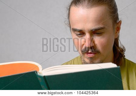Young Hairy Man Reading