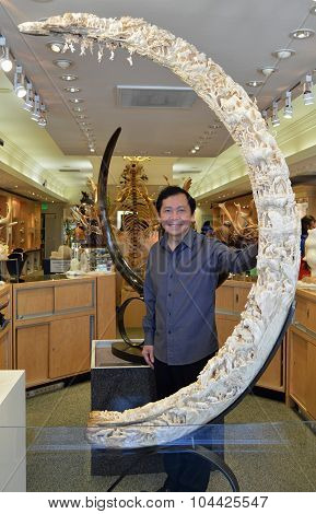 Artist Eddie Lee Poses With His Woolly Mammoth Sculptor