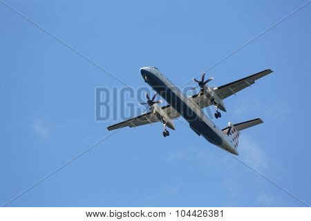 ZAGREB, CROATIA - JUNE 10: Bombardier DH8D, registration 9A-CQD of Croatia Airlines landing on Zagreb Airport Pleso on June 10, 2015.