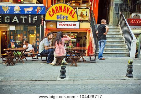 Visitors of street cafe sitting outdoor in Istanbul