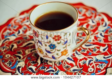 Cup of coffee on the lovely traditional-style tray painted