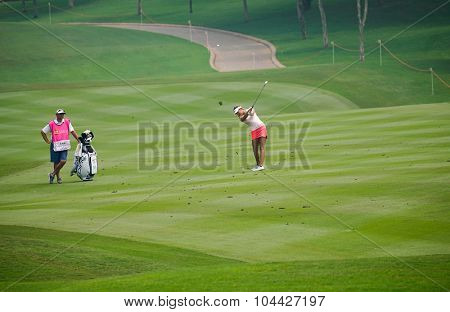 KUALA LUMPUR, MALAYSIA - OCTOBER 10, 2015: USA's Alison Lee plays on the fairway of the 18th hole of the Kuala Lumpur Golf & Country Club during the 2015 Sime Darby LPGA Malaysia golf tournament.