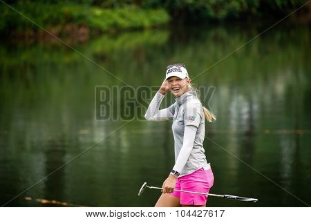 KUALA LUMPUR, MALAYSIA - OCTOBER 10, 2015: USA's Jessica Korda reacts to the fans' cheers at the 18th hole of the KL Golf & Country Club during the 2015 Sime Darby LPGA Malaysia golf tournament.