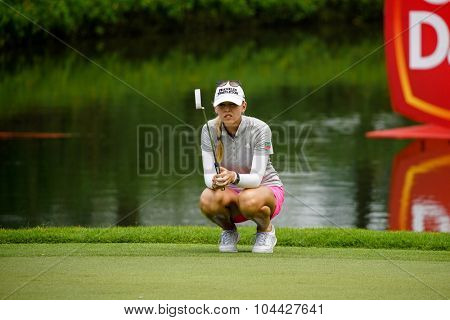 KUALA LUMPUR, MALAYSIA - OCTOBER 10, 2015: USA's Jessica Korda checks the green of the 18th hole of the KL Golf & Country Club during the 2015 Sime Darby LPGA Malaysia golf tournament.