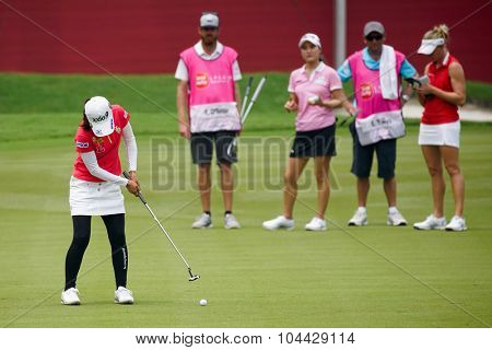 KUALA LUMPUR, MALAYSIA - OCTOBER 10, 2015: Japan's Sakura Yokomine putts on the green of the 18th hole of the KL Golf & Country Club during the 2015 Sime Darby LPGA Malaysia golf tournament.