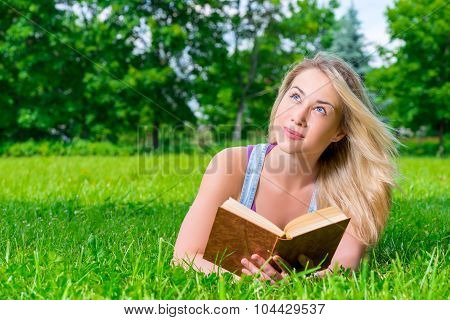 Portrait Of A Pensive Dreamy Girl With Novel