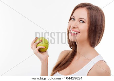 Cheerful young woman prefers healthy fresh food