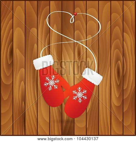 Vector illustration pair of red christmas mittens on wooden background. Mitten icon.