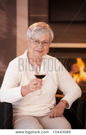 Portrait Of Senior Woman With Glass Of Wine