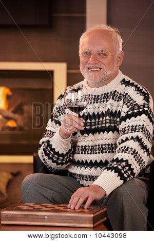 Portrait Of Happy Senior Man Having Wine