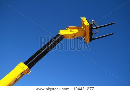Pointing Forklift Against The Sky
