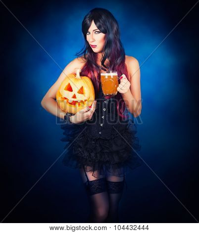 Beautiful witch in black gothic Halloween costume