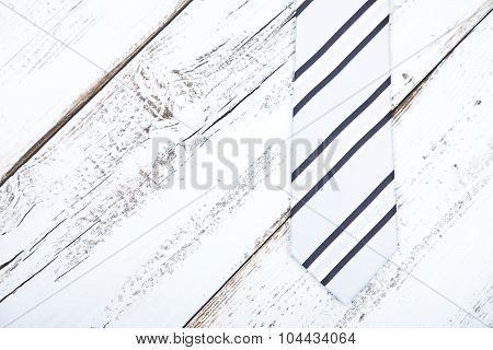 Business Tie On Light Blue Wooden Background