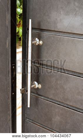 Gray Door With Metal Handle