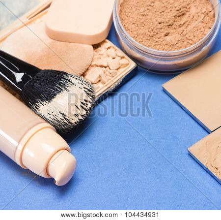 Set Of Makeup Products To Make Even Skin Tone On Blue