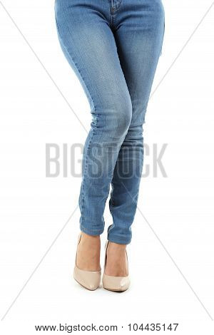 Female Legs In Beige High-heeled Shoes And Jeans On White Background