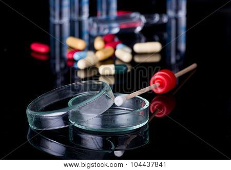 Petri Dish With Pills And Ampoules