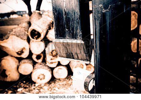 wood splitter in action, wood for fire in winter