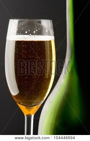 Wine glass and Bottle, isolated on black background.