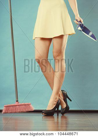 Elegant Woman Sweeping Floor With Broom