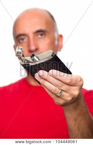Man holding a flask