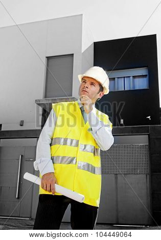 Young Attractive Architect Worker Supervising Building Blueprints Outdoors Wearing Construction Helm
