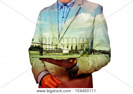 Double Exposure Of Businessman And Silo Warehouse