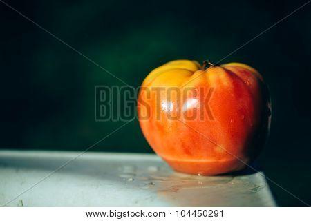 One unripe tomato.