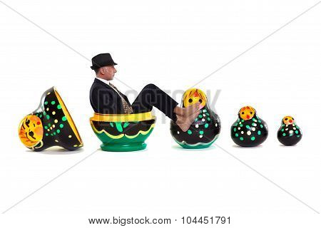 Matryoshka. Man popping out of a set of painted Russian nesting dolls