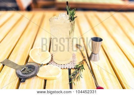 Alcoholic Drink With Gin Tonic, Lime, Rosemary And Ice Served Cold At Local Pub, Bar Or Restaurant.