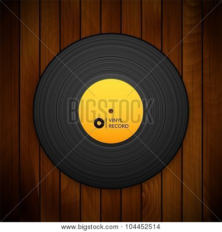 Black vintage vinyl record isolated on red wood texture background