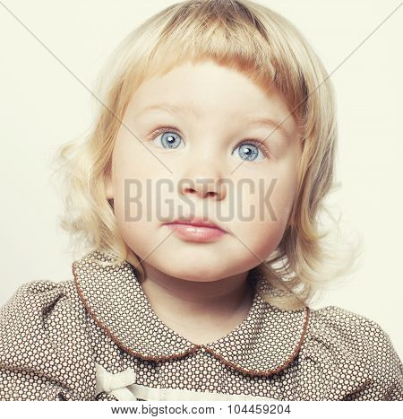 little cute blond girl close up isolated on white background