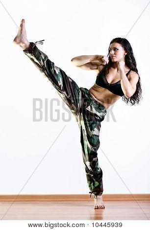 Young Woman Kicking