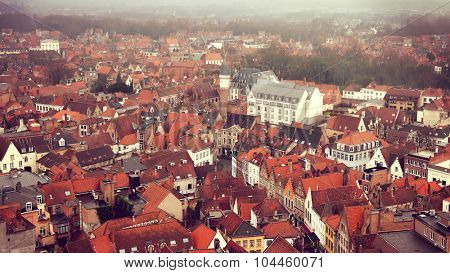 Roofs of Bruges,  Belgium. Top view on the historic center. Toned image