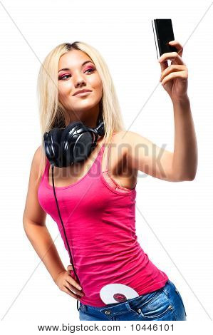 Young Woman With Headphones And Mobile Phone