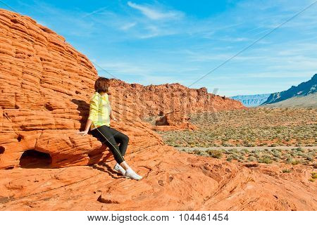 Woman Enjoying View Of Red  Rock Formations In Valley Of Fire State Park.