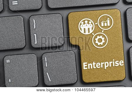 Golden enterprise key on keyboard