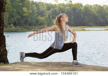 Beautiful Young Blonde Woman With Athletic Body Doing Stretching Exercise Outdoors