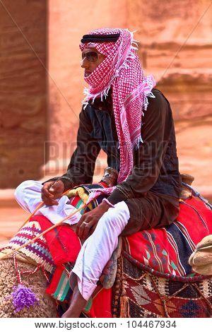 Traditional Bedouin Man On Camel In Petra Jordan