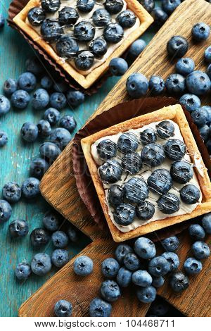 Gourmet fresh blueberry tarts on table