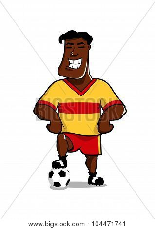 Victorious soccer player posing with a ball