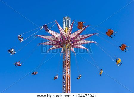 A chair swing ride shot in blue sky