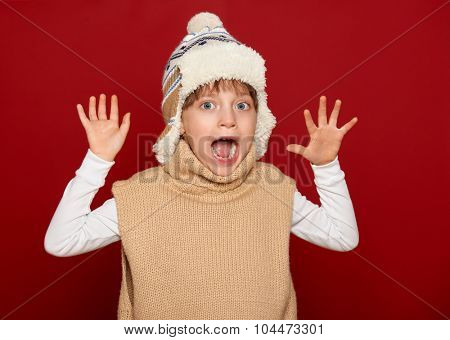 winter, people, happiness concept - girl in hat and sweater on red open arms
