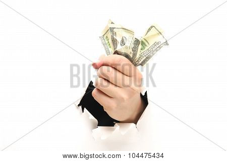 A female hand with dollars isolated tearing a white paper