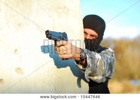 Terrorist With Mask And Gun